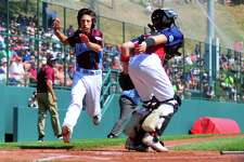Fairfield American's Matthew Vivona reaches home plate to score the first run during Little League World Series action against Mid-Atlantic at Lamade Stadium in South Williamsport, Penn., on Thursday Aug. 17, 2017. Osmond missed the ball allowing Cutler to score.