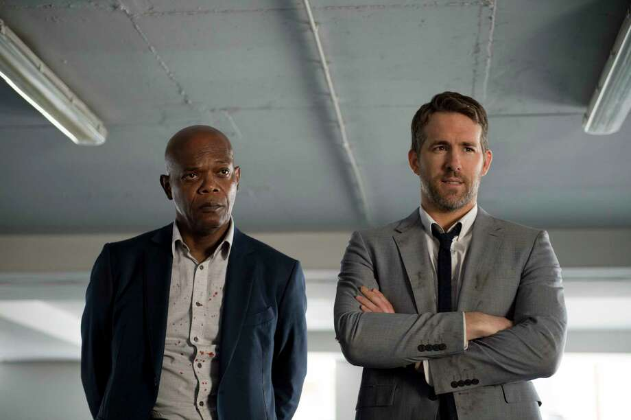 "This image released by Lionsgate shows Samuel L. Jackson, left, and Ryan Reynolds in ""The Hitman's Bodyguard."" (Jack English/Lionsgate via AP) ORG XMIT: NYET861 Photo: Jack English / Bodyguard Productions, Inc."