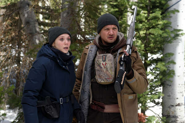 """Elizabeth Olsen and Jeremy Renner in """"Wind River."""" MUST CREDIT: Fred Hayes, The Weinstein Company"""