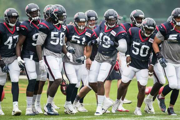 Houston Texans defenders run to their next drill during a joint practice between the Texans and the New England Patriots at training camp at The Greenbrier on Wednesday, Aug. 16,  2017, in White Sulphur Springs, W.Va. ( Brett Coomer / Houston Chronicle )