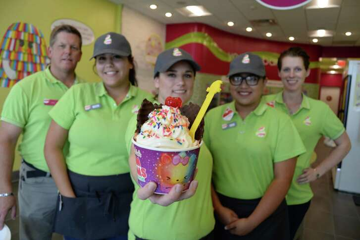 Christopher Wilson, left, and his wife Kim have opened Menchie's in Pasadena, which is staffed by Maddy Samples, Robyn French and Jovana Acuna,