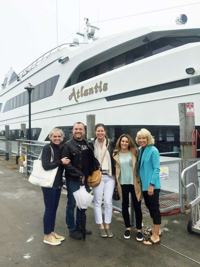From left, Jen Warwick, gala co-chair and daughter of guest of honor Margie Warwick, gala committee members Tom Anthan and Kim Anthan, co-chair Gina Mele and Florence Griffin, Pathways' executive director, pose by the Atlantis Yacht earlier in the year. The agency's gala on Sept. 9 will be held on the yacht. Photo: Contributed /