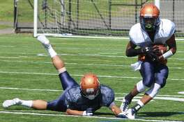 Receiver Zatrell Lyons, right, catches a pass as Adrian Aviles defends during football practice at Western Connecticut State University's Westside Athletic Complex in Danbury Aug. 17, 2017.