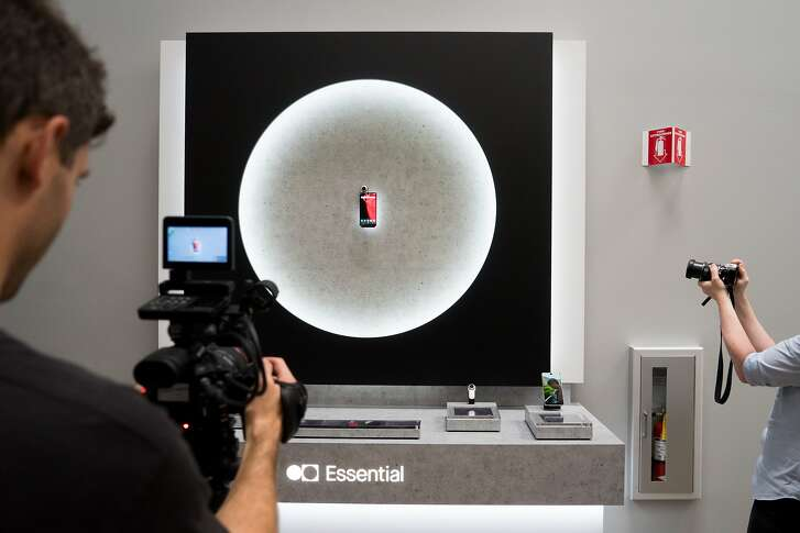People take photo and video of the new Essential smartphone at Playground Global in Palo Alto, Calif. on Tuesday, Aug. 15, 2017. Essential is releasing a phone that allows a 360 degree camera to be easily attached.