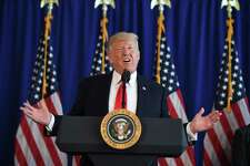 """President Donald Trump speaks to the press about the protests in Charlottesville, Va., at Trump National Golf Club in Bedminster, N.J., on Sunday. His initial statements on the incident drew criticism because he laid the blame on """"many sides,"""" but — let's face it — the blame Trump crowd would have laid the events at his feet even if they had written it themselves."""