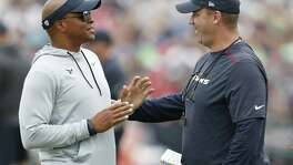Houston Texans general manager Rick Smith (left) talks to coach Bill O'Brien during a joint practice between the Texans and the New England Patriots at training camp at The Greenbrier on Aug. 16, 2017, in White Sulphur Springs, W.Va.
