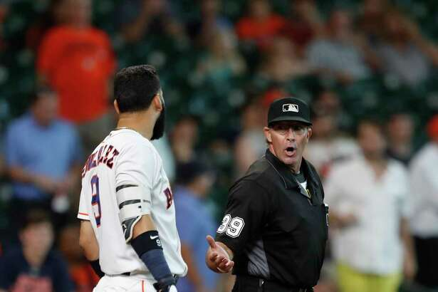 Houston Astros Marwin Gonzalez (9) argues with home plate umpire Paul Nauert after striking out to end in the game during an MLB game at Minute Maid Park, Thursday, Aug. 17, 2017, in Houston.