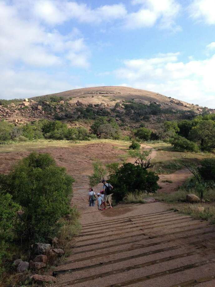 Park rangers recorded a surface temperature of 133 degrees at the Enchanted Rock State Natural Area Thursday. Photo: Dale Blasingame / For The Express-News