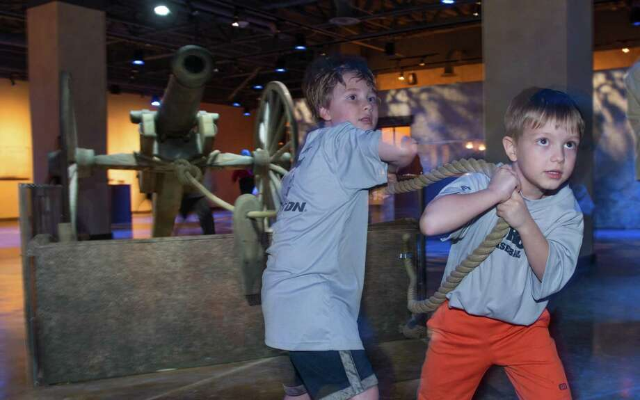 """The family-friendly attraction """"Battle for Texas: The Experience"""" promises visitors an immersive history lesson about the Alamo and Texas, such as being able to pull a replica cannon. Photo: Courtesy Battle For Texas: The Experience / Copyright 2016  Jerstad Photographics  LLC. Case#1-188973047"""