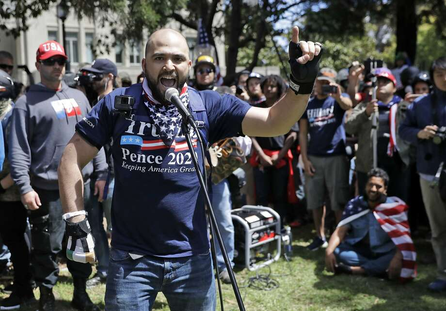 """In this April 27, 2017, file photo, Joey Gibson speaks during a rally in Berkeley, Calif. Gibson's group has applied for a permit for an Aug. 26 rally at Crissy Field that many officials fear will attract armed militias and white nationalist groups. Gibsonsaid Friday that he had decided to cancel the event and hold a """"press conference"""" instead. Photo: Marcio Jose Sanchez, AP"""