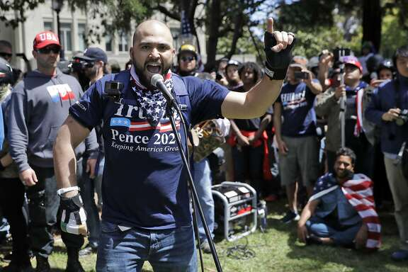 FILE--In this April 27, 2017, file photo, Joey Gibson speaks during a rally in Berkeley, Calif. Gibson's group has applied for a permit for an Aug. 26 rally at Crissy Field that many officials fear will attract armed militias and white nationalist groups.