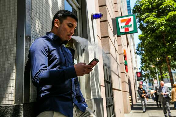 Mark Armendarez smokes outside 7-Eleven on Mission Street in San Francisco, Calif., on Thursday, Aug. 17, 2017. 7-Eleven sells nicotine lozenges by the brand Zonnic.