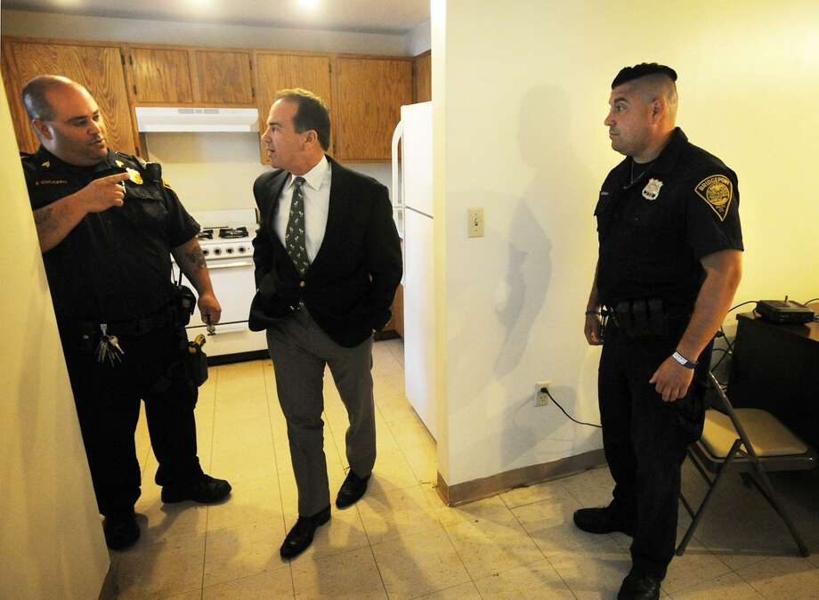 Bridgeport Mayor Joe Ganim, center, tours the reactivated police post at P.T. Barnum Apartments with Sgt. Frank Cuccaro, left, and Officer Michael Salemme in Bridgeport, Conn. on Thursday, August 17, 2017. Photo: Brian A. Pounds / Hearst Connecticut Media / Connecticut Post