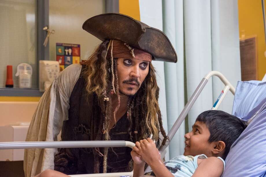 "Patients at BC Children's Hospital were delighted by a visit today with one of the world's most famous pirates, Captain Jack Sparrow. Hollywood actor Johnny Depp arrived at the hospital dressed dread to toe as his character from ""The Pirates of the Caribbean"" movie franchise. The charismatic character charmed patients and their families alike, leaving smiles and laughter in his wake during his 5 1/2 hour visit. (BC Children's Hospital Foundation)"