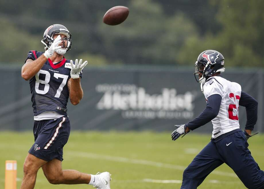 Houston Texans tight end C.J. Fiedorowicz (87) reaches back to make a catch against free safety Kurtis Drummond (23) during training camp at The Greenbrier on Monday, Aug. 14, 2017, in White Sulphur Springs, W.Va. ( Brett Coomer / Houston Chronicle ) Photo: Brett Coomer/Houston Chronicle