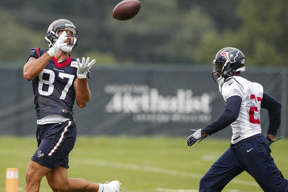 Houston Texans tight end C.J. Fiedorowicz (87) reaches back to make a catch against free safety Kurtis Drummond (23) during training camp at The Greenbrier on Monday, Aug. 14, 2017, in White Sulphur Springs, W.Va. ( Brett Coomer / Houston Chronicle )