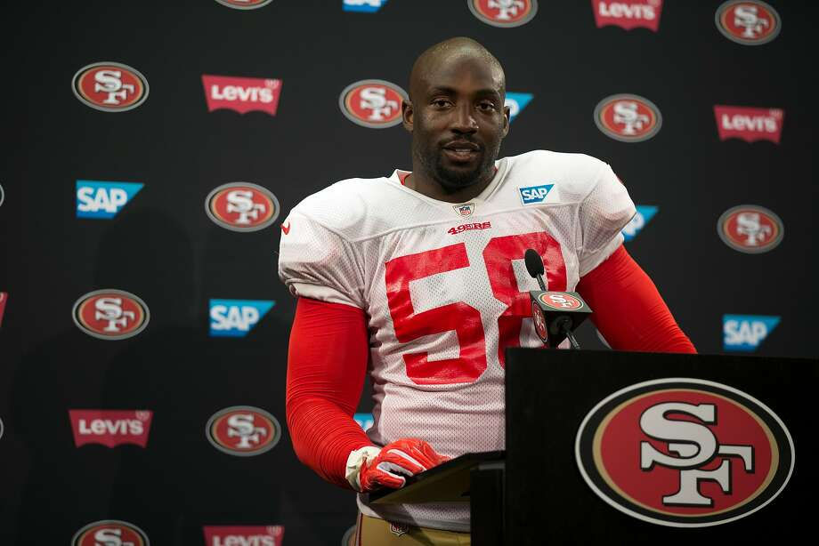 San Francisco 49ers linebacker Elvis Dumervil answers questions from reporters at a press conference following the team's joint workout with the Denver Broncos, on Wednesday, Aug. 16, 2017 in Santa Clara, Calif. Photo: D. Ross Cameron, Special To The Chronicle