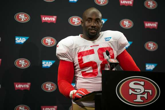 San Francisco 49ers linebacker Elvis Dumervil answers questions from reporters at a press conference following the team's joint workout with the Denver Broncos, on Wednesday, Aug. 16, 2017 in Santa Clara, Calif.