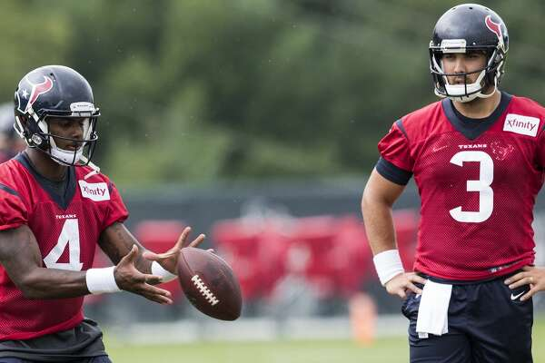 Houston Texans quarterback Deshaun Watson (4) takes a snap as quarterback Tom Savage looks on during training camp at The Greenbrier on Monday, Aug. 14, 2017, in White Sulphur Springs, W.Va. ( Brett Coomer / Houston Chronicle )