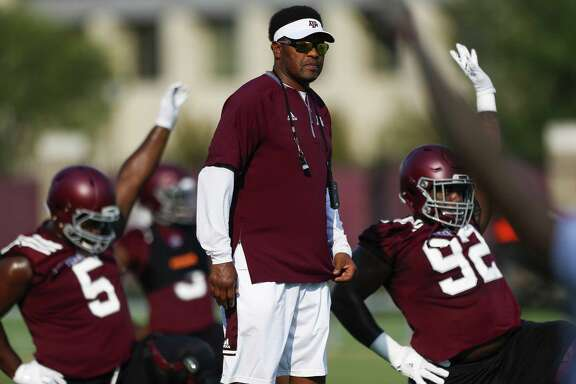 Texas A&M coach Kevin Sumlin watches over warm-ups during practice at the Coolidge Practice Fields on Aug. 4, 2017 in College Station.