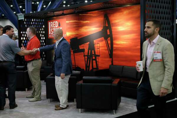 The Red Stone Resources booth is shown during the North American Prospect Expo (NAPE), an annual gathering of oil land buyers and sellers, at the George R. Brown Convention Center, 1001 Avenida De Las Americas, Thursday, Aug. 17, 2017, in Houston. ( Melissa Phillip / Houston Chronicle )