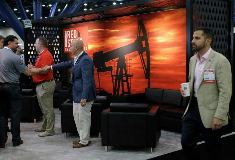 Red Stone Resources, a mineral purchasing company from Oklahoma, had a booth Thursday at NAPE, a semiannual gathering of oil land buyers and sellers, at the George R. Brown Convention Center.  Photo: Melissa Phillip, Staff / © 2017 Houston Chronicle