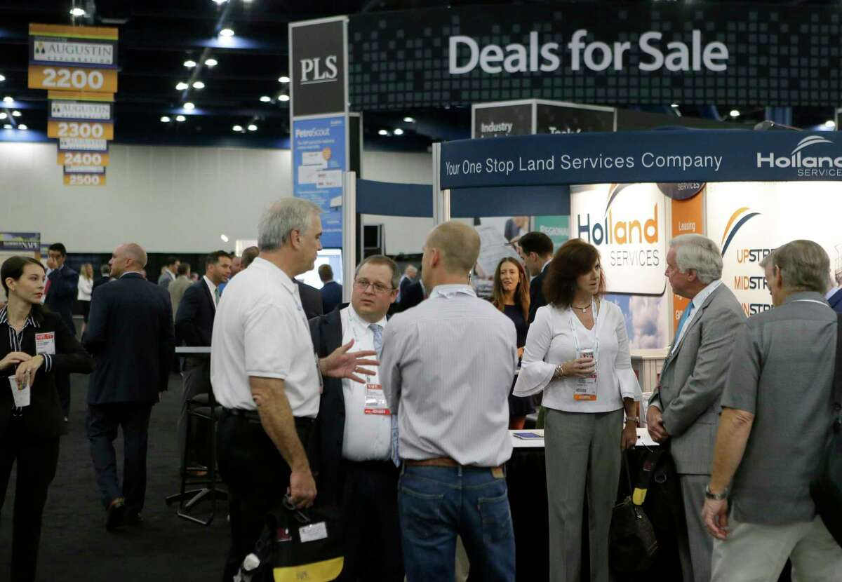 People are shown at the North American Prospect Expo (NAPE), an annual gathering of oil land buyers and sellers, at the George R. Brown Convention Center, 1001 Avenida De Las Americas, Thursday, Aug. 17, 2017, in Houston. ( Melissa Phillip / Houston Chronicle )