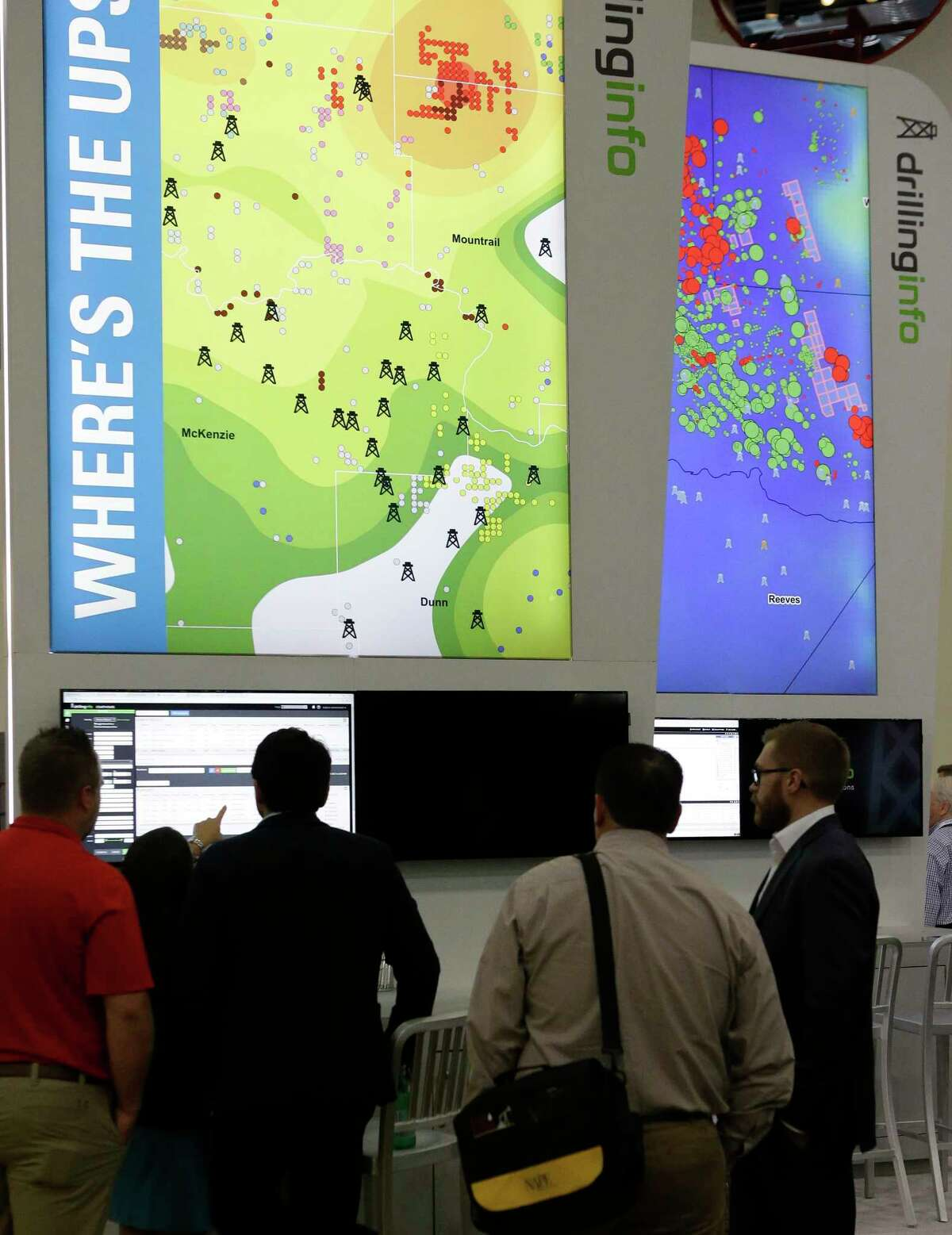 People are shown at the Drilling Info booth during the North American Prospect Expo (NAPE), an annual gathering of oil land buyers and sellers, at the George R. Brown Convention Center, 1001 Avenida De Las Americas, Thursday, Aug. 17, 2017, in Houston. ( Melissa Phillip / Houston Chronicle )