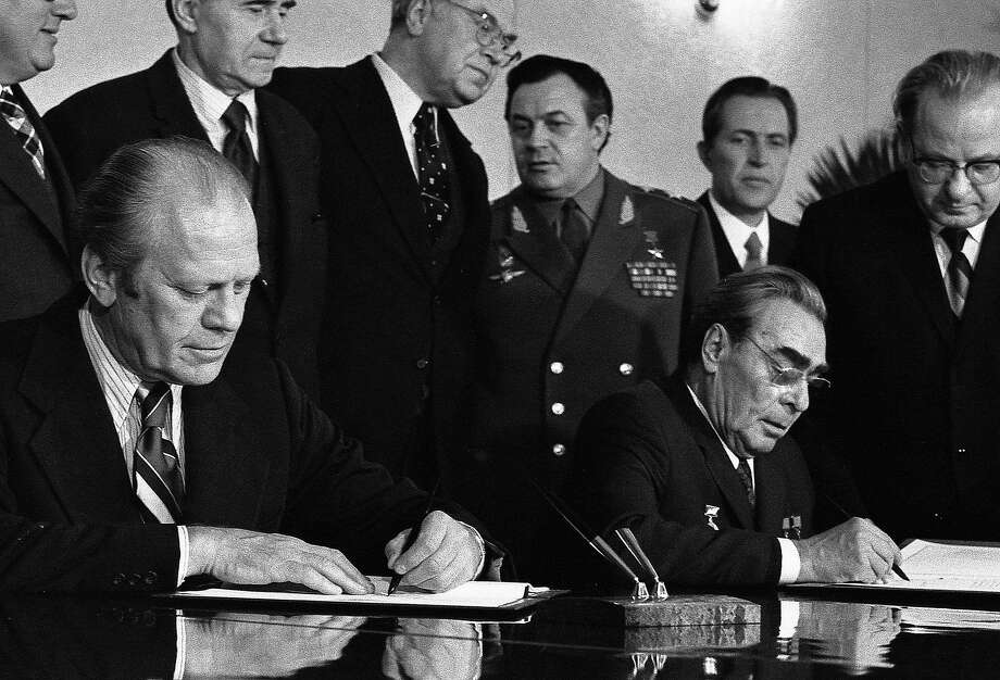 President Gerald Ford and Soviet General Secretary Leonid Brezhnev sign a joint communique after 1974 talks on the limitation of strategic offensive arms. Photo: AP