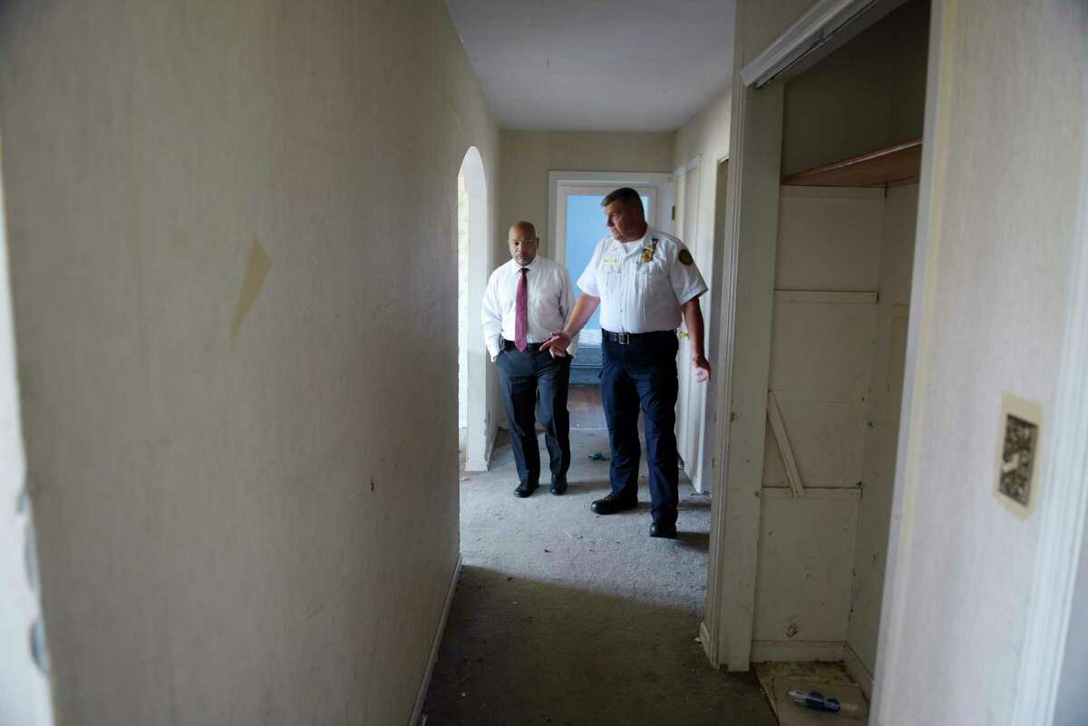 Assembly Speaker Carl Heastie, left, and Jerry Paris, Albany County fire coordinator, walk through a home used for training at the Colonie Fire Training Facility on Thursday, Aug. 17, 2017, in Latham, N.Y. Speaker Heastie was taking a tour of the Capital Region on Thursday. (Paul Buckowski / Times Union)