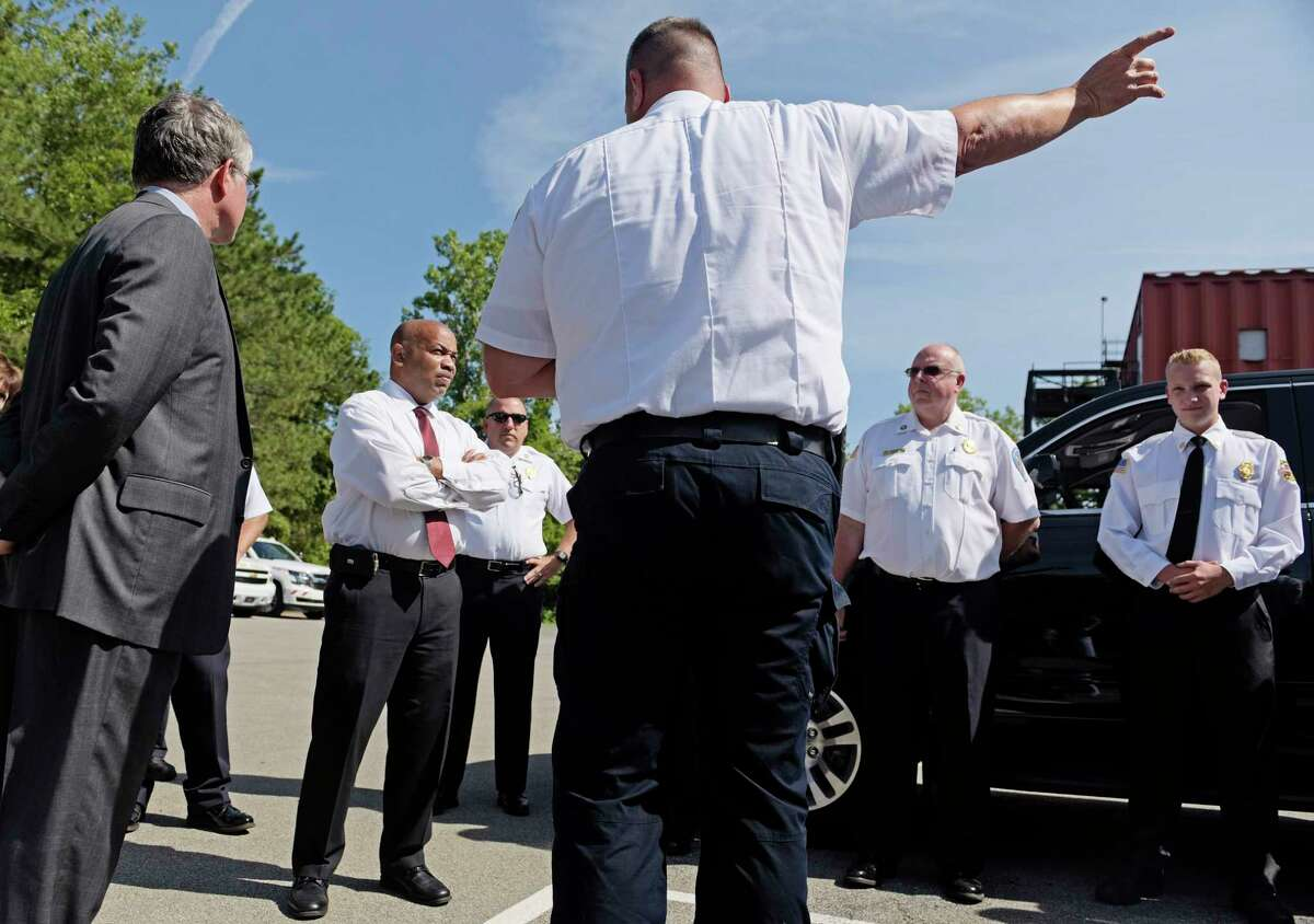 Assemblyman Phil Steck, left, and Assembly Speaker Carl Heastie, second from left, talk with Jerry Paris, Albany County fire coordinator at the Colonie Fire Training Facility on Thursday, Aug. 17, 2017, in Latham, N.Y. Speaker Heastie was taking a tour of the Capital Region. (Paul Buckowski / Times Union)