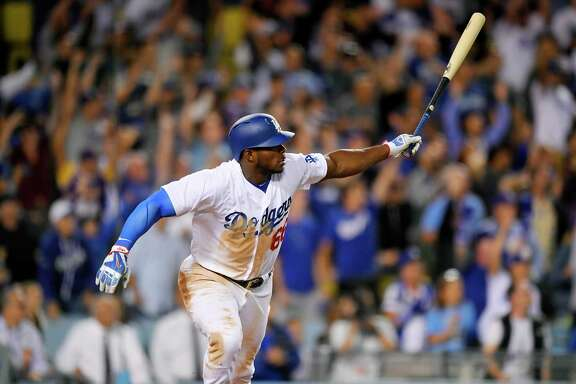 Los Angeles Dodgers' Yasiel Puig watches his  two-run double that gave the Dodgers a 5-4 win against the Chicago White Sox in the ninth inning of a baseball game, Wednesday, Aug. 16, 2017, in Los Angeles. (AP Photo/Mark J. Terrill)