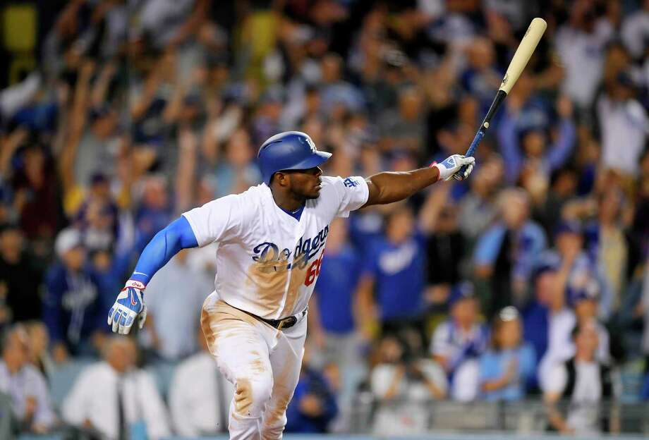 Los Angeles Dodgers' Yasiel Puig watches his  two-run double that gave the Dodgers a 5-4 win against the Chicago White Sox in the ninth inning of a baseball game, Wednesday, Aug. 16, 2017, in Los Angeles. (AP Photo/Mark J. Terrill) Photo: Mark J. Terrill, STF / Copyright 2017 The Associated Press. All rights reserved.