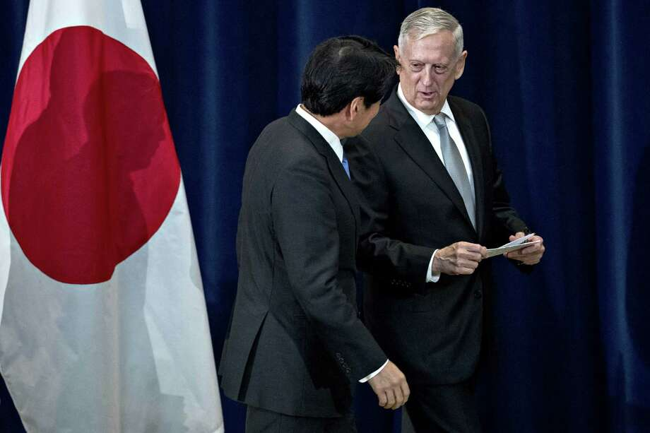 James Mattis, U.S. secretary of defense, right, reassures Itsunori Onodera, Japan's defense minister, of the United States' North Korea strategy after confusion was caused by U.S. officials' contradicting statements. Photo: Andrew Harrer / © 2017 Bloomberg Finance LP