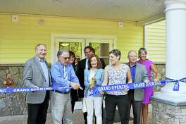 From left, James Pascarella, Louis Tagliatela Jr., Lauren Tagliagela, Dale Kroop, Tricia Tagliatela and Nancy Dudchik cut the ribbon at grand opening of Canal Crossing at Whitneyville West apartment complex in Hamden.