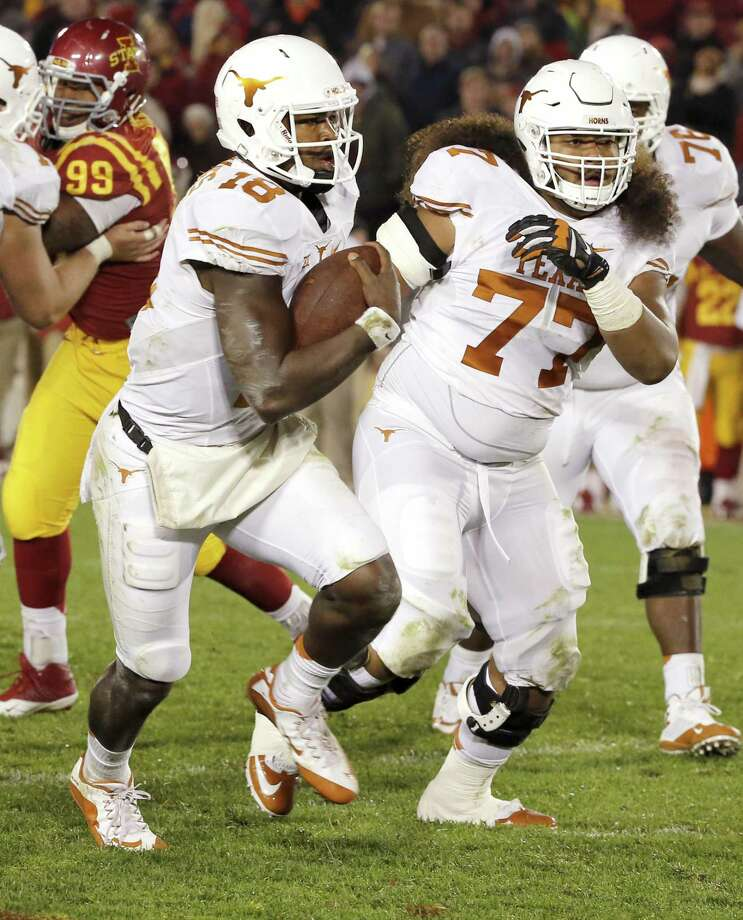 Quarterback Tyrone Swoopes (18_ of the Texas Longhorns runs with blocking from offensive lineman Patrick Vahe (77) in the second half against the Iowa State Cyclones at Jack Trice Stadium on Oct. 31, 2015, in Ames. Photo: David K Purdy /Getty Images / 2015 David K Purdy