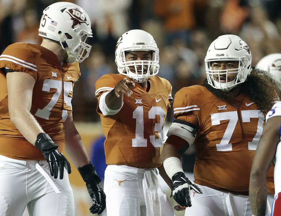 Jerrod Heard directs linemen Tristan Nickelson a(75) and Patrick Vahe as Texas hosts Kansas at DKR Stadium on November 7, 2015. Photo: TOM REEL, STAFF / SAN ANTONIO EXPRESS-NEWS / 2015 SAN ANTONIO EXPRESS-NEWS