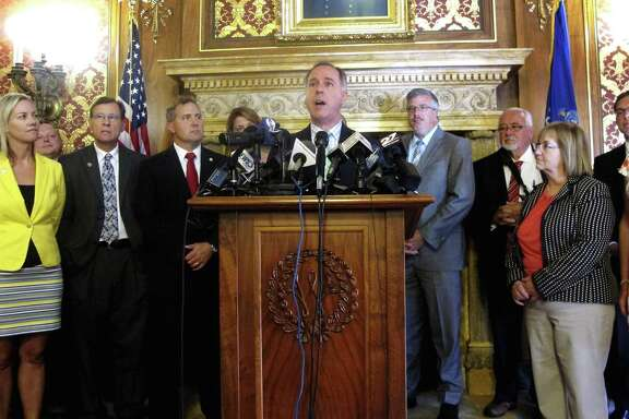 Wisconsin state Assembly Speaker Robin Vos joins with fellow Republicans to defend a $3 billion tax break package for electronics giant Foxconn Technology Group that the Assembly passed on Thursday in Madison, Wis.