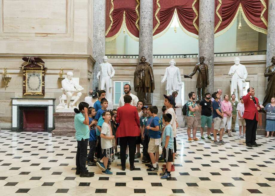 A tour in front of statues, including that of Confederate president Jefferson Davis, third from left (it is the bronze statue in the middle here), in Statuary Hall of the Capitol Building in Washington. Rep. Nancy Pelosi urged the removal of Confederate statues from the Capitol. Photo: JUSTIN T. GELLERSON, STR / NYTNS