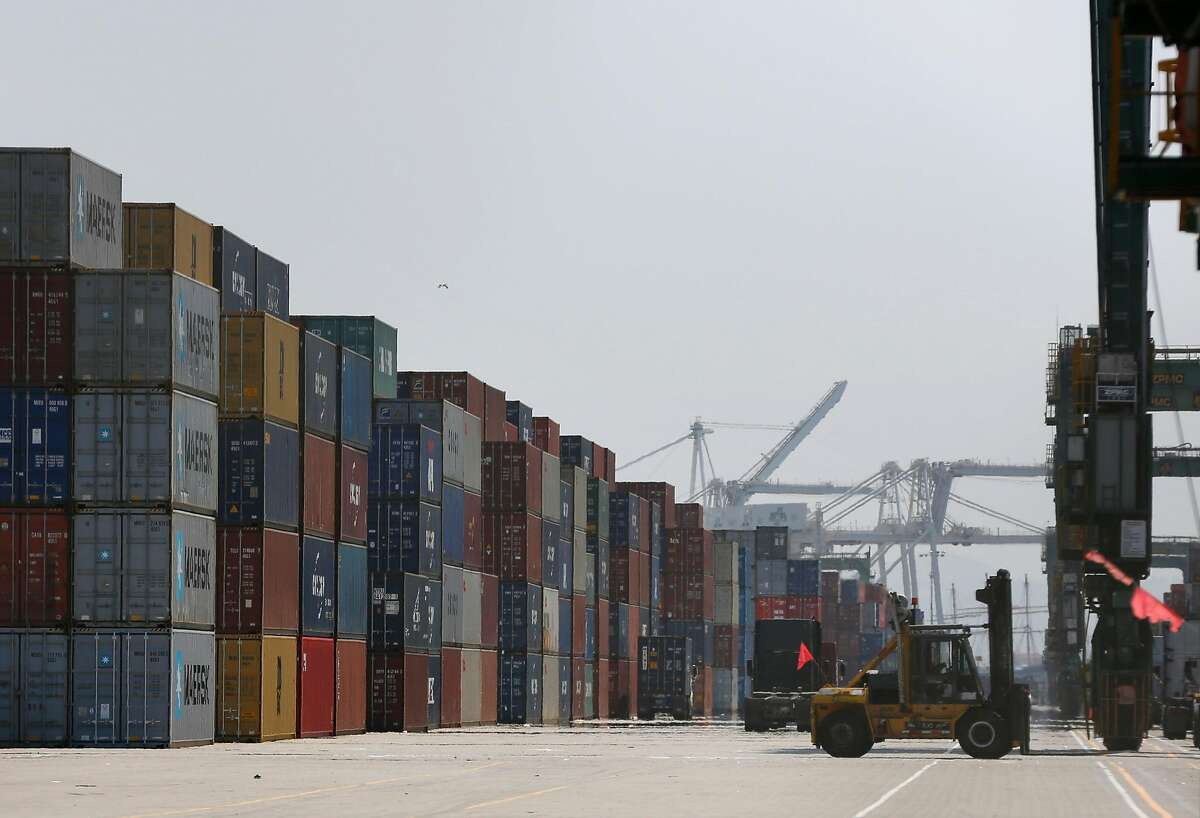 A forklift drives around shipping containers at the Port of Oakland August 17, 2017 in Oakland, Calif.