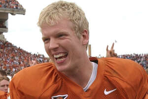 UT quarterback Chris Simms was all smiles following the Longhorns 50-20 thrashing of Texas A&M in Austin Friday afternoon.            11/29/02       Karl Stolleis/Houston Chronicle