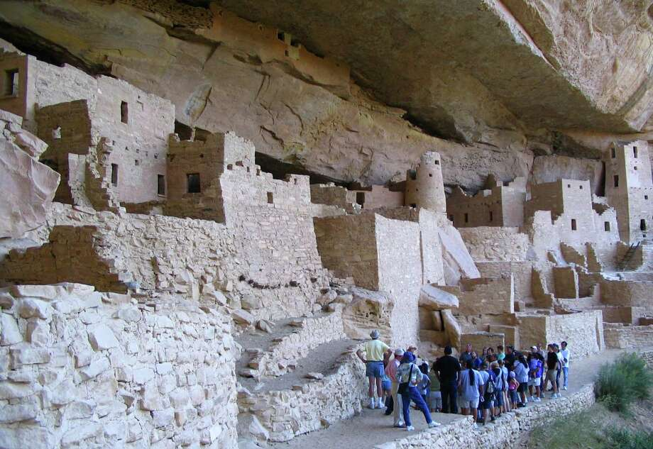 Visitors tour Cliff Palace, an ancient cliff dwelling in Mesa Verde National Park, Colo. New evidence may help solve the mystery of what happened to the Ancestral Puebloans who lived there. Photo: BETH J. HARPAZ, STF / AP2006