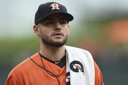 Houston Astros pitcher Lance McCullers walks to the dugout before playing the Baltimore Orioles in a baseball game, Sunday, July 23, 2017, in Baltimore. (AP Photo/Gail Burton)