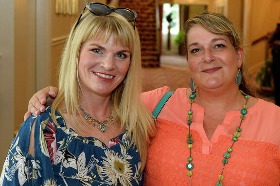 Alicia McKibbin and Carrie Arriete during the Heritage Happy Hour at the Julie Rogers Theatre on Thursday evening.  Photo taken Thursday 8/17/17 Ryan Pelham/The Enterprise