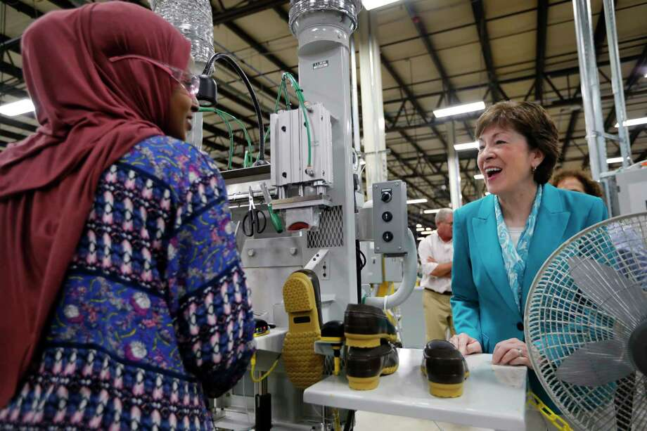 Sen. Susan Collins, R-Maine, speaks with a worker Thursday while visiting L.L. Bean's new manufacturing center in Lewiston, Maine. The company hopes to make 750,000 pairs of boots this year. Photo: Robert F. Bukaty, STF / Copyright 2017 The Associated Press. All rights reserved.