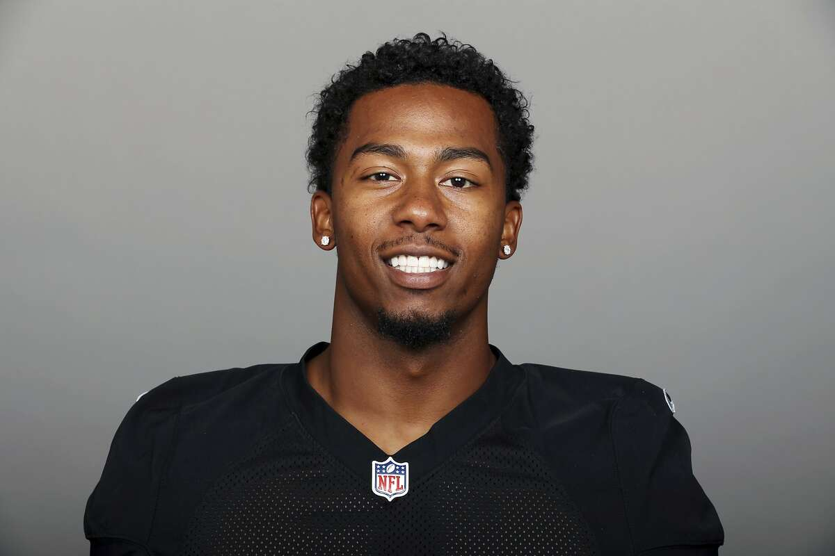 In a 2016 file photo, Oakland Raiders cornerback Sean Smith poses for a photo. The Los Angeles County District Attorney's Office says Smith was charged with assault and battery in connection with a July 4, 2017, incident. They say Smith beat the victim and then stomped on the man's head in Pasadena, Calif. (AP Photo)