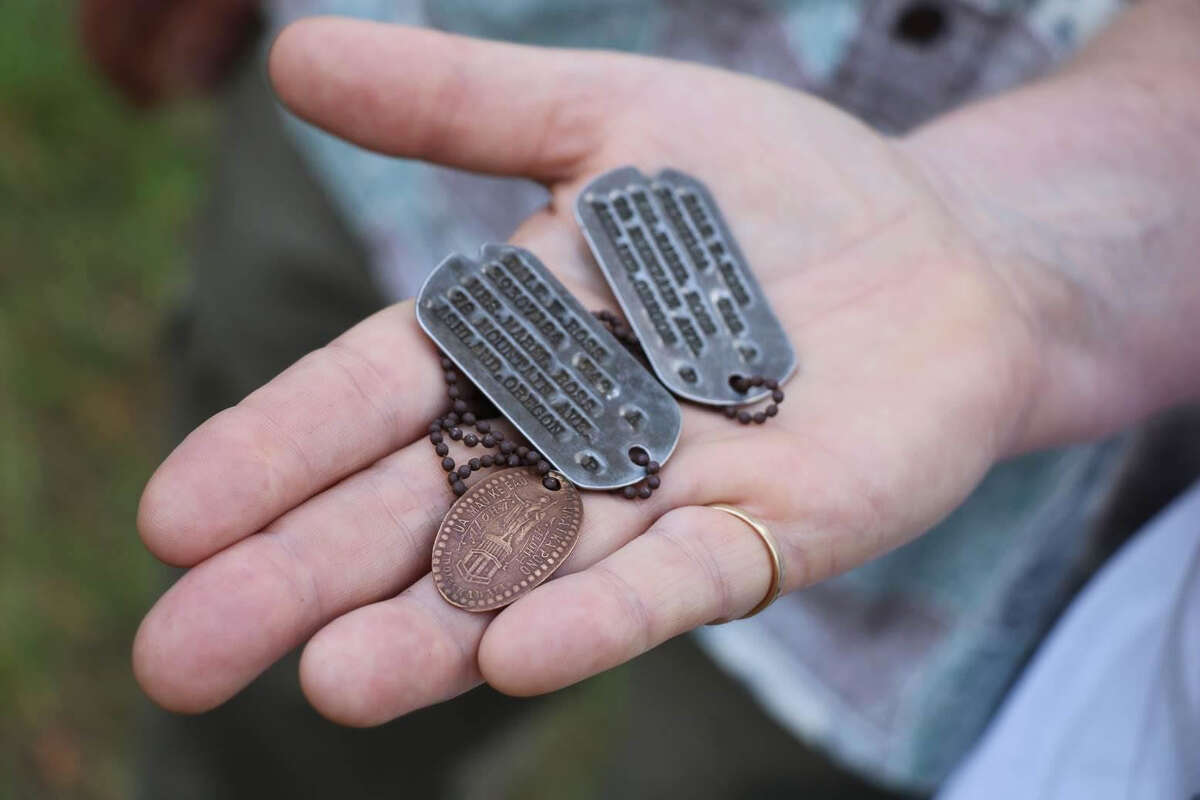 In this Aug. 3, 2017 photo, the dog tags and a Hawaiian pressed penny charm of Pfc. Dale W. Ross are displayed at Guadalcanal in the Solomon Islands. Ross, a North Dakota native, was assigned to the Army's 25th Infantry Division and was reported missing in action in January 1943 during the Guadalcanal campaign. (Justin Taylan/Pacific Wrecks via AP) ORG XMIT: NYR203