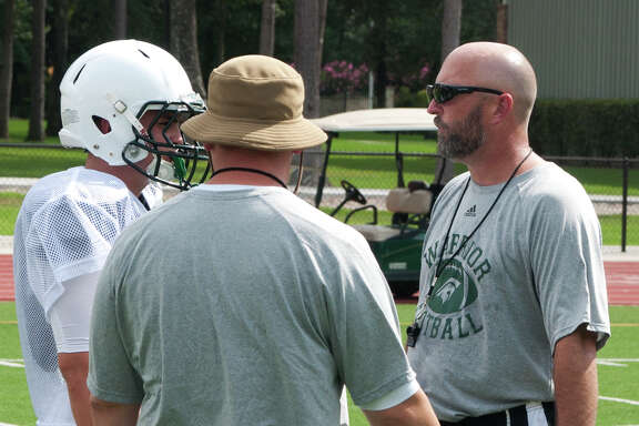 TWCA coach Randy Hollas talks to a player during a drill at practice on Wednesday at The Woodlands Christian Academy.