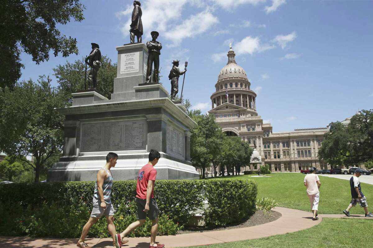 Tourist proceed around the huge Confederate monument to Texas Civil War veterens located at the south entrance to the Capitol grounds on August 16, 2017.