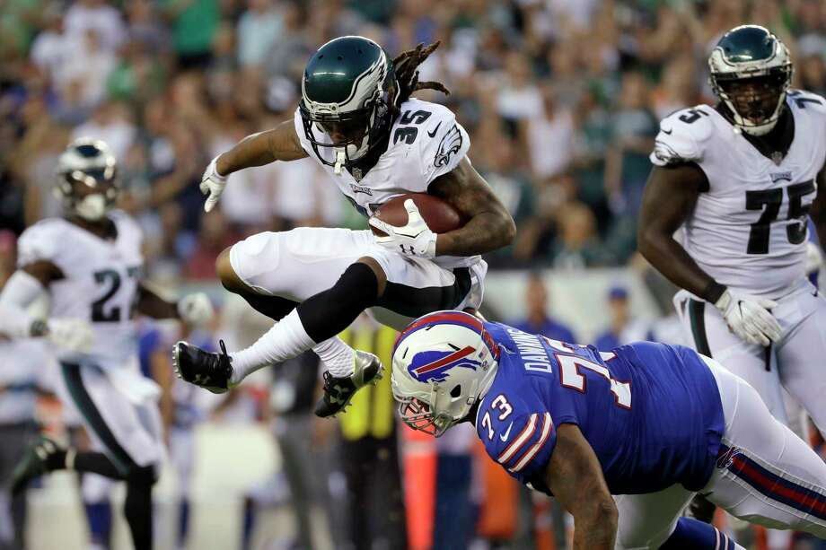 Philadelphia Eagles' Ronald Darby (35) returns an interception against Buffalo Bills' Dion Dawkins (73) during the first half of an NFL preseason football game, Thursday, Aug. 17, 2017, in Philadelphia. (AP Photo/Michael Perez) ORG XMIT: PXE109 Photo: Michael Perez / FR168006 AP